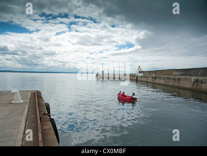 3 people in a pleasure dingy sailing out into the Moray Firth.  SCO 8419 - Stock Photo