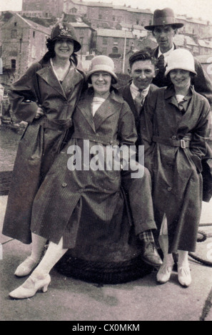 A group of friends dressed up for the British summer weather at the seaside in the 1920s, England, UK - Stock Photo
