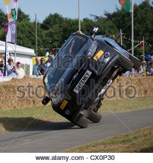 Paul Swift drives a Ford Focus on two wheels at Carfest North, promoting The Sweeney movie. - Stock Photo