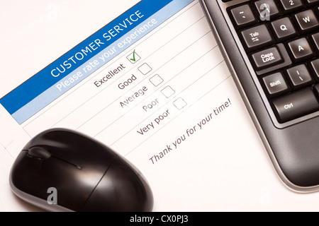 Excellent checkbox on customer service satisfaction survey with keyboard and mouse - Stock Photo