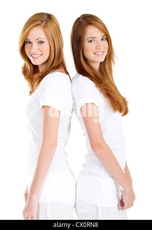happy teen girls back to back on white background - Stock Photo