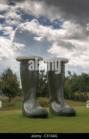 A gigantic pair of empty green wellington boots an exhibit at Floriade 2012 Netherlands - Stock Photo