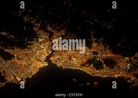 Istanbul and the Bosporus strait appear in this night view from space - Stock Photo
