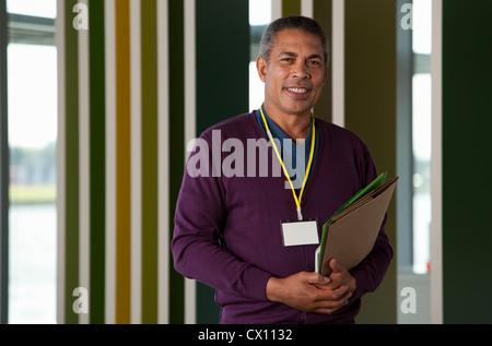 Man holding files, portrait - Stock Photo