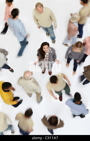 Woman standing in crowd of people, high angle view - Stock Photo