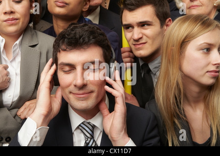 Businesswoman wearing headphones on subway train - Stock Photo
