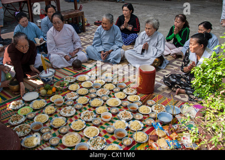 A group of unidentified women pray outside a buddhistic temple during a local festival on January 7, 2008 in Nha - Stock Photo
