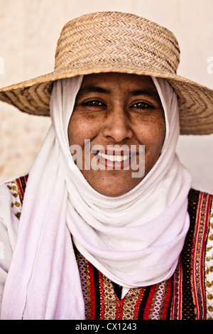 Portrait of a young woman wearing hat and headscarf in Djerba, Tunisia - Stock Photo