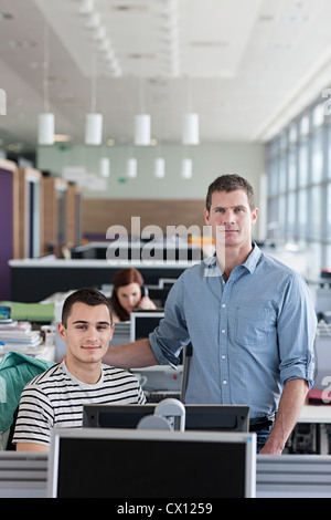 Colleagues in office interior, portrait - Stock Photo