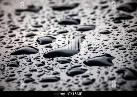 Drops of rain on the surface of a polished car. - Stock Photo