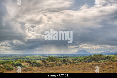 A rain shower passes by the Nephin Beg mountain in County Mayo in the West of ireland - Stock Photo