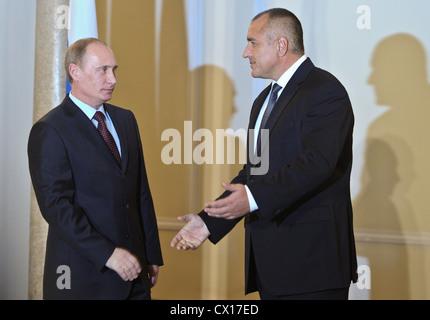 ITAR-TASS: SOFIA, BULGARIA. NOVEMBER 13, 2010. Russian Prime Minister Vladimir Putin (L) welcomes Bulgarian Prime - Stock Photo