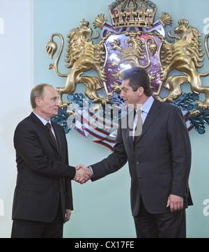ITAR-TASS: SOFIA, BULGARIA. NOVEMBER 13, 2010. Russian Prime Minister Vladimir Putin and Bulgarian President Georgi - Stock Photo