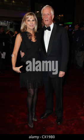ITAR-TASS: LONDON, UK. NOVEMBER 30, 2010. Director MIchael Apted with girlfiend attends the Royal Film Performance - Stock Photo