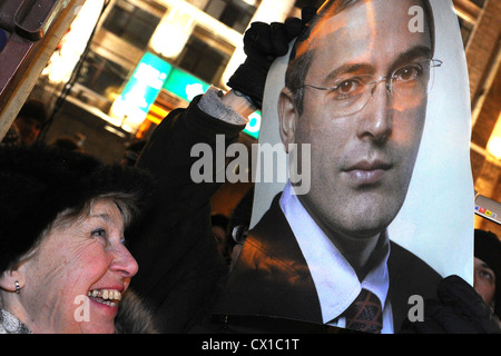 ITAR-TASS: MOSCOW, RUSSIA. DECEMBER 31, 2010. Demonstrator holds an image of Mikhail Khodorkovsky during an opposition - Stock Photo