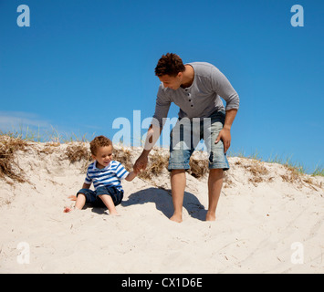 Dad and son enjoying and having fun on a sunny summer day - Stock Photo