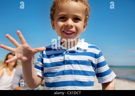 Closeup of an adorable and cute little kid enjoying the outdoors - Stock Photo