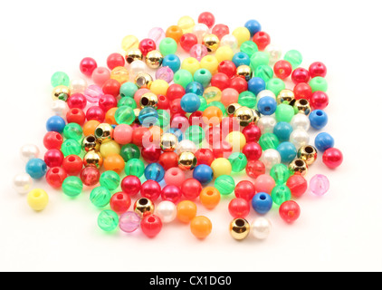 Spheres of plastic over a white background. - Stock Photo
