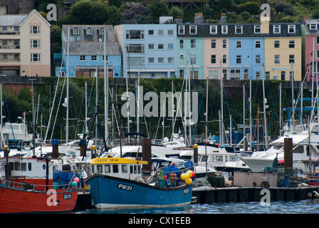 FIshing Boats and Yachts Infront of Pastel Houses in Dartmouth, England - Stock Photo