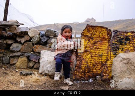 Children in the rain - Stock Photo