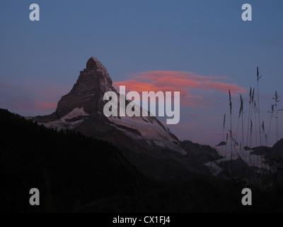 Pink Cloud Over The Matterhorn - Stock Photo