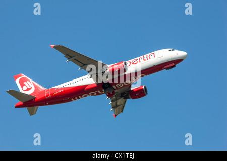 Passenger jet plane taking off from Düsseldorf International Airport. Air Berlin, Airbus A320-214, - Stock Photo