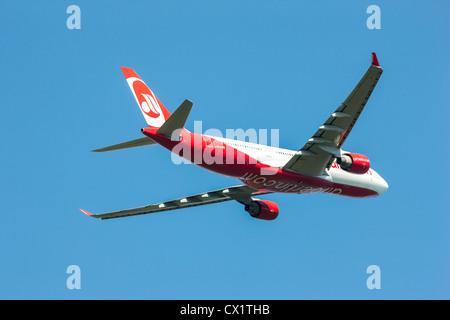 Passenger jet plane taking off from  Düsseldorf International Airport. Air Berlin, Airbus A330-223, - Stock Photo