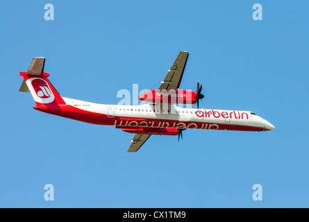 Passenger jet plane taking off from Düsseldorf International Airport. Air Berlin,  Bombardier DHC 8Q-400, - Stock Photo