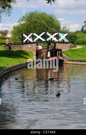 58' narrowboat 'Felicity' emerges from Lock No.19 on the Stratford-upon-Avon Canal near Lapworth, Warwickshire, - Stock Photo