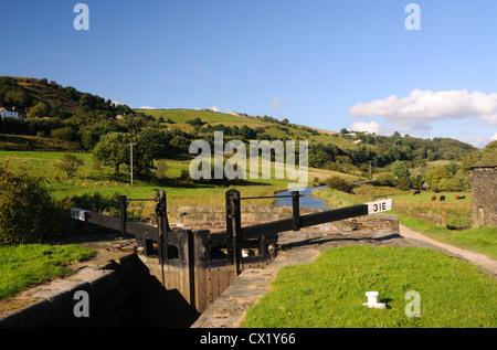 Lock No.31E on the Huddersfield Narrow Canal near Lingards Wood, Yorkshire, England - Stock Photo