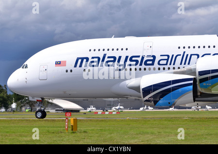 Airbus A380 in the colours of Malaysia Airlines rolling out after landing at Farnborough International Airshow 2012 - Stock Photo
