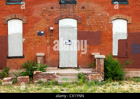 No Trespassing Sign on Old Abandoned Building - Stock Photo