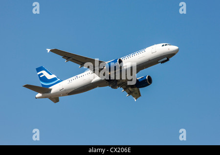 Passenger jet plane taking off form Düsseldorf International Airport. Finnair, Airbus A320, - Stock Photo