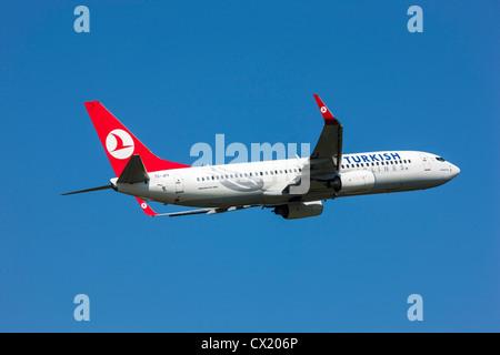 Passenger jet plane taking off form Düsseldorf International Airport. Turkish Airlines, Boeing 737-800, - Stock Photo