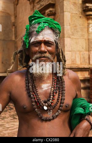 Elk201-4808v India, Tamil Nadu, Thanjavur, Brihadishwara Temple, sadhu (holy man) - Stock Photo