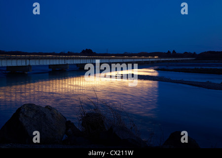 Car at night crossing bridge across Waitaki River, North Otago / South Canterbury, South Island, New Zealand - Stock Photo