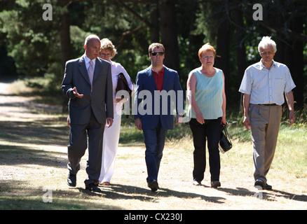 ITAR-TASS: FINLAND. JULY 22, 2010. Russian president Dmitry Medvedev (C), Finland's president Tarja Halonen with - Stock Photo