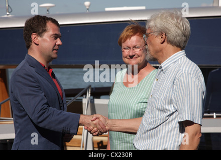 ITAR-TASS: FINLAND. JULY 22, 2010. Russian president Dmitry Medvedev (L), Finland's president Tarja Halonen with - Stock Photo