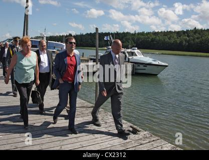 ITAR-TASS: FINLAND. JULY 22, 2010. Russian president Dmitry Medvedev (C), Finland's president Tarja Halonen, director - Stock Photo
