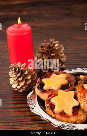 Traditional Christmas sweets with a fruity filling - Stock Photo