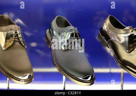 Louis Vuitton mens luxury designer label footwear on display at a boutique in Singapore. - Stock Photo