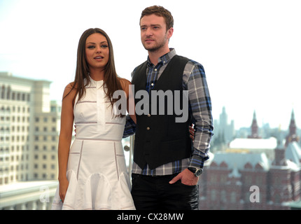 MOSCOW, RUSSIA. JULY 27. 2011. Actors Mila Kunis (L) and Justin Timberlake hold a photo session on the roof of Ritz - Stock Photo