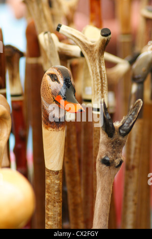 Wooden walking sticks shaped as duck head for sale - Stock Photo