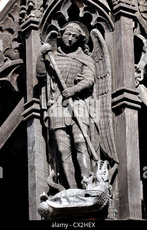 A wooden carving on the Lych Gate of St Michael's Parish Church in Abergele, North Wales, depicting St Michael. - Stock Photo