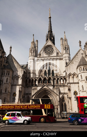 sightseeing  open topped bus and taxi outside the Royal Courts of Justice in Fleet Street London - Stock Photo
