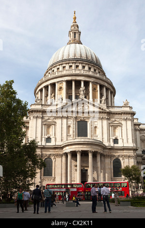 Saint Paul's and the dome with red London buses. - Stock Photo