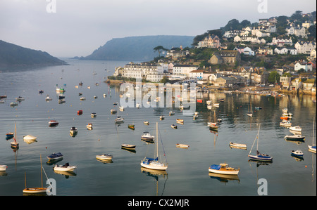 Early morning sunlight on Salcombe and the yachts in Kingsbridge Estuary, South Hams, Devon, England. Autumn (September) - Stock Photo