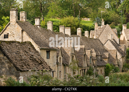 Picturesque cottages at Arlington Row in the Cotswolds village of Bibury, Gloucestershire, England. Summer (September) - Stock Photo