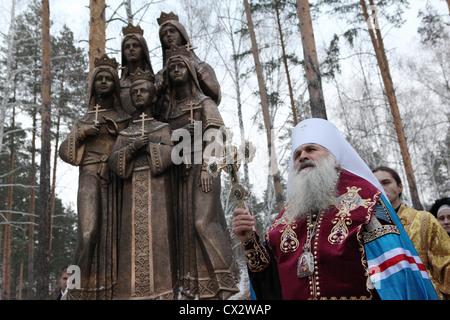 SVERDLOVSK REGION, RUSSIA. NOVEMBER 16. 2011. An Orthodox priest blesses the monument depicting the children of - Stock Photo