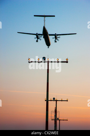 Passenger airplane approaching Düsseldorf International Airport. Germany. - Stock Photo